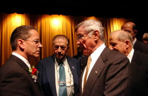After his inauguration in 2003 as New Britain's mayor, Timothy Stewart talks with those in attendance including (from l-r) former mayors Paul Manafort, William McNamara, and tax collector Fred Menditto.