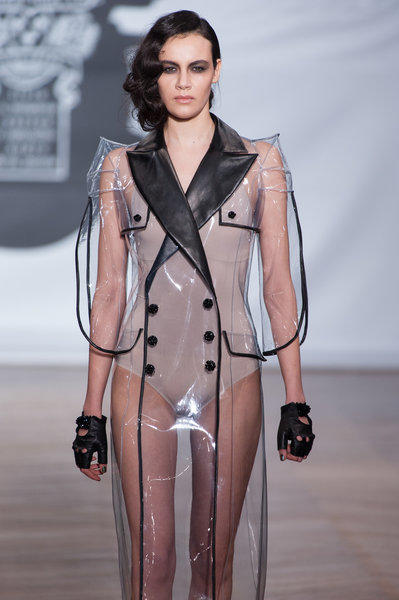A model shows a transparent coat at On Aura Tout Vu's Paris haute couture show.