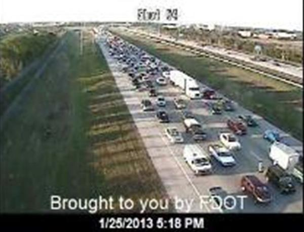 A rollover crash on Interstate 75 jams traffic during the rush hour in Miramar