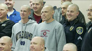 Elkhart police shave heads to show support for fellow officer