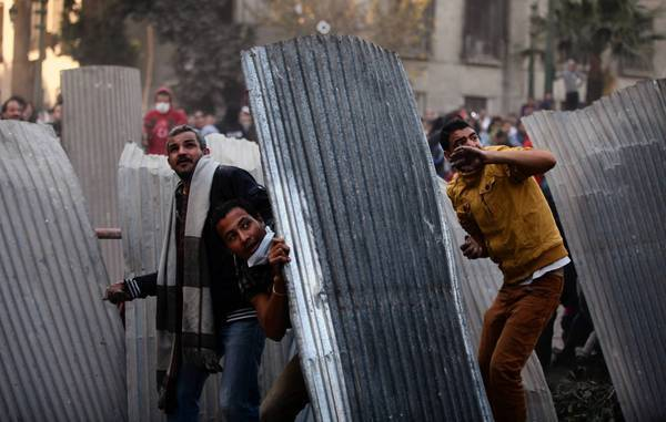 Egyptian protesters clash with riot police in Cairo's Tahrir Square on the two-year anniversary of the nation's revolution.