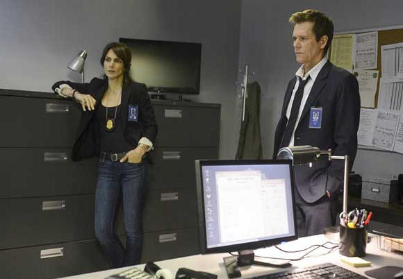"Annie Parisse and Kevin Bacon in ""The Following"" on Fox."