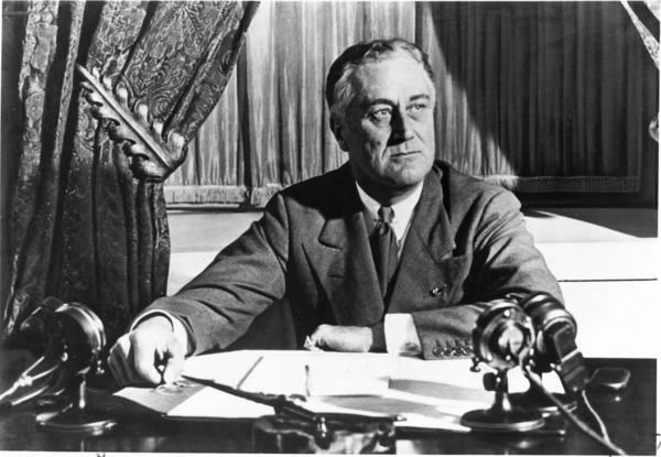 Franklin Delano Roosevelt sits at his desk in 1933, his first year as president.