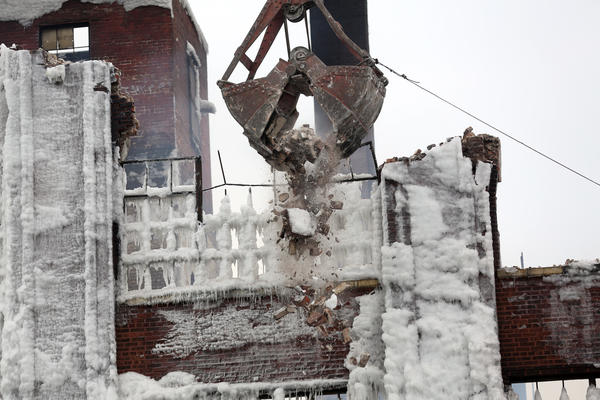 Demolition continues Friday on a warehouse that was gutted by a massive extra-alarm blaze earlier this week in Chicago's Bridgeport neighborhood. Keri Wiginton/Chicago Tribune