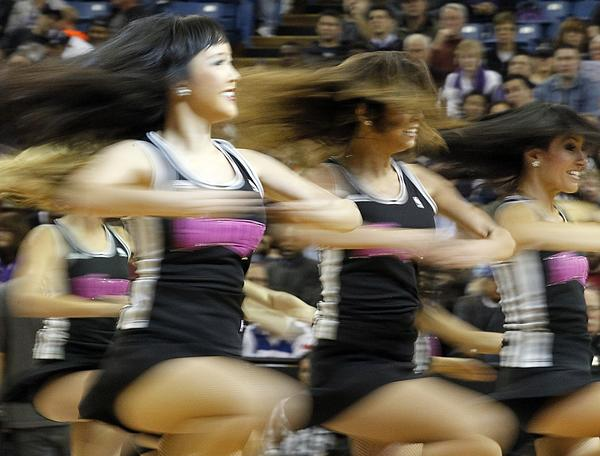 The Sacramento Kings dance team performs during a break in the action between the Kings and the Phoenix Suns at Sleep Train Arena.