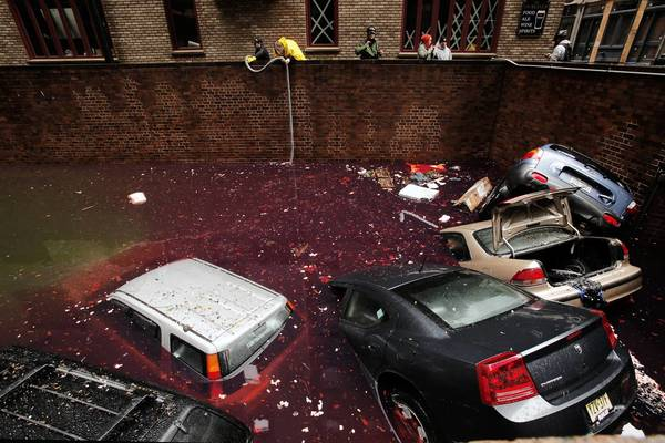 Cars in a garage float in a mixture of storm water and gasoline in lower Manhattan during Superstorm Sandy.