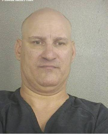 Michael Sibelle, 45, is accused of stabbing his partner, 65, with a fork and biting his earloabe in Wilton Manors