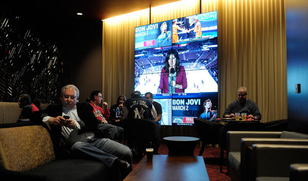 Florida Panthers fans relax inside Club Red at the BB&T Center before the start of a Florida Panthers game.