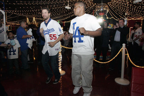 "LA Dodgers' Matt Guerrier, from third left, dances with Jonathan McCowan during the Dodgers 10th annual Community Caravan ""Pitching in the Community,"" which took place at Tobinworld in Glendale on Friday, January 25, 2013."