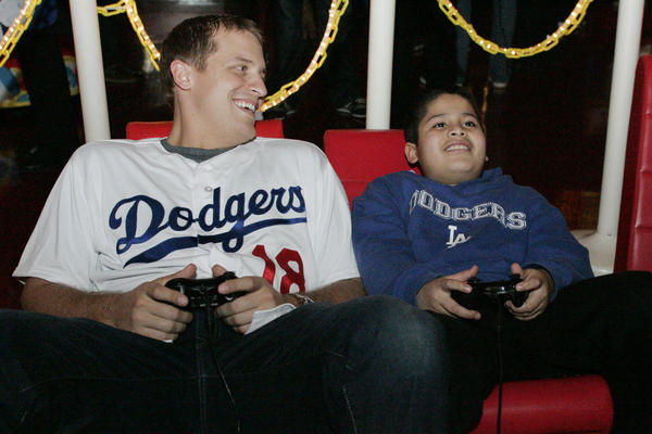"LA Dodgers' Tim Federowicz, left, plays halo with Tobinworld student Brandon Molina during the Dodgers 10th annual Community Caravan ""Pitching in the Community,"" which took place at Tobinworld in Glendale on Friday, January 25, 2013."