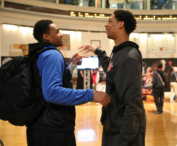 Simeon's Jabari Parker, left, and Young's Jahlil Okafor talk at the Basketball Hall of Fame in Springfield, Mass., last weekend.