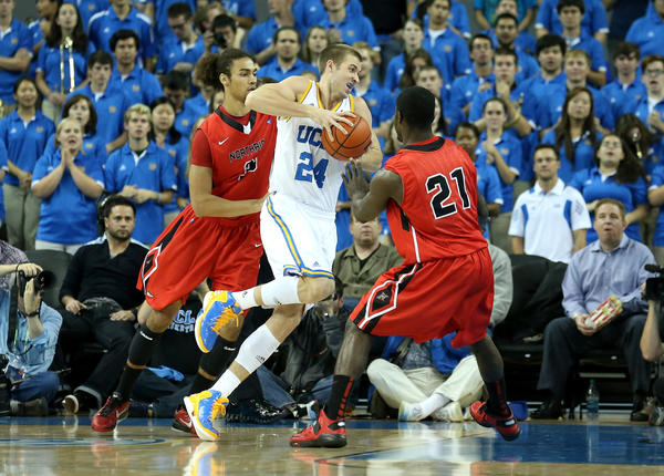 UCLA forward Travis Wear drives against Cal State Northridge's Tre Hale-Edmerson and Stephen Maxwell (21) at Pauley Pavilion.