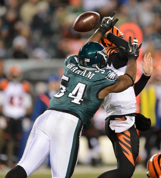Philadelphia Eagles defensive end Brandon Graham (54) forces a fumble by Cincinnati Bengals quarterback Andy Dalton (14) at Lincoln Financial Field in Philadelphia on Thursday.
