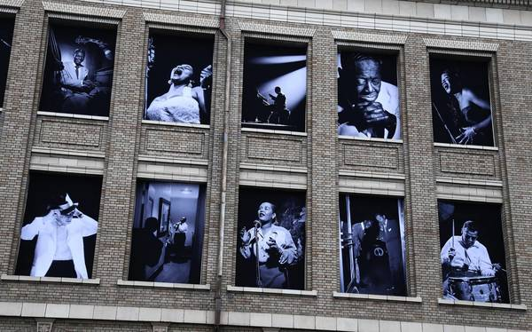 Large jazz photographs by Herman Leonard are displayed on a building across the street from the opening night concert of the SFJAZZ Center in San Francisco.