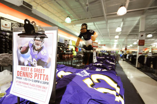 A flyer advertising Ravens tight end Dennis Pitta's visit to Modell's Sporting Goods store in Parkville greets shoppers and fans as they enter.