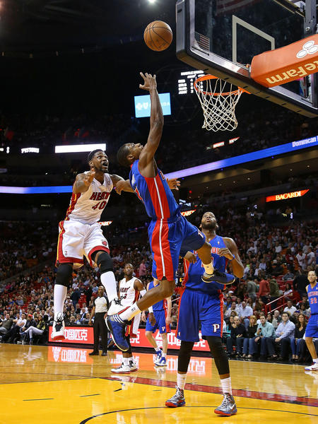 Brandon Knight #7 of the Detroit Pistons drives past Udonis Haslem #40 of the Miami Heat during a game  at American Airlines Arena on January 25, 2013 in Miami, Florida.