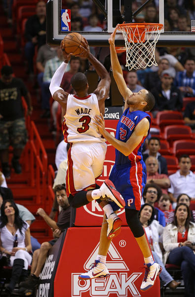 Dwyane Wade #3 of the Miami Heat shoots over Tayshaun Prince #22 of the Detroit Pistons during a game  at American Airlines Arena on January 25, 2013 in Miami, Florida.
