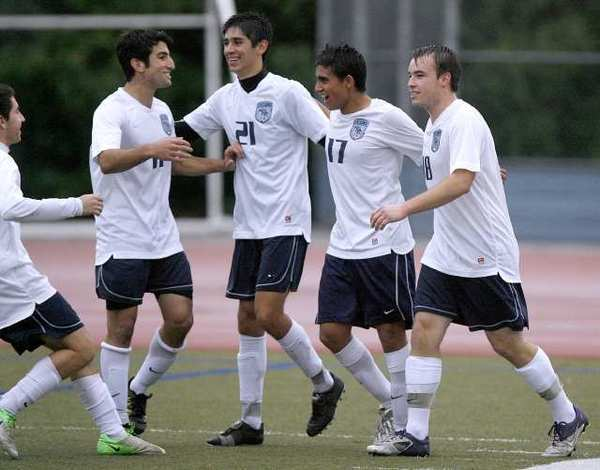 Crescenta Valley's #17 Pablo Sotillo celebrates after scoring a late goal to help the Falcons earn a 1-1 tie.