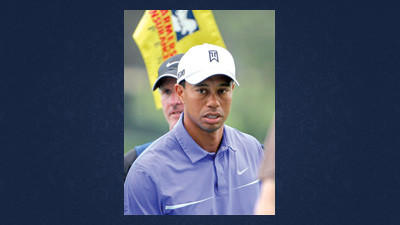 Tiger Woods holds a two-shot lead following the second round of the Farmers Insurance Open on Friday.