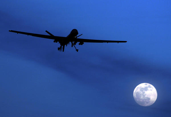 "An unmanned U.S. Predator drone flies over Kandahar Air Field in Jan. 2010. The Obama administration is preparing a ""playbook"" of rules for targeted killings of suspected terrorists abroad."