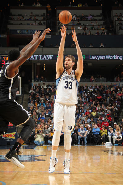 Marc Gasol #33 of the Memphis Grizzlies shoots against Andray Blatche #0 of the Brooklyn Nets.