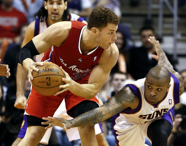 Clippers power forward Blake Griffin tries to protect the ball from the steal attempt of Suns swingman P.J. Tucker in the second half.