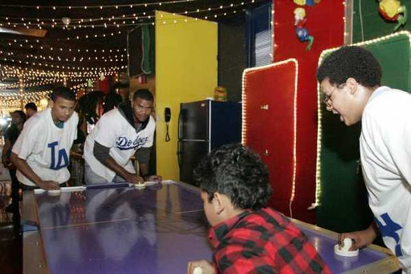 Marquise Patterson, left, teams up with the LA Dodgers' Kenley Jansen for a round of air hockey at Tobinworld in Glendale.