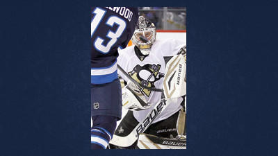 Pittsburgh Penguins' goaltender Tomas Vokoun, right, stops a shot from Winnipeg Jets' Kyle Wellwood (13) during second-period NHL hockey game action in Winnipeg, Manitoba, Friday.