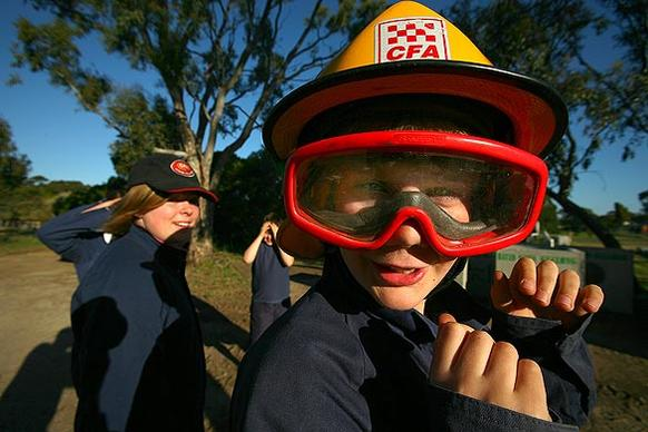 "Liam Hodges, a 12-year-old ""junior firey,"" receives training from the County Fire Authority in Anakie, Australia."
