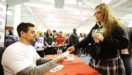 Baltimore Ravens' star Dennis Pitta signs autographs at Modell's Sporting Goods