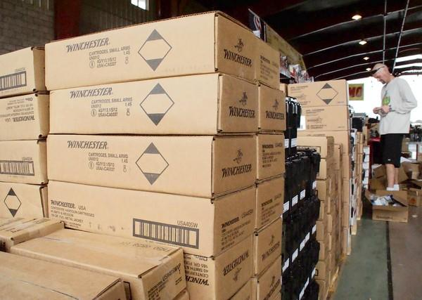 Boxes of Winchester ammunition are stacked for this weekend's Crossroads of the West Gun Show at the O.C. Fairgrounds.