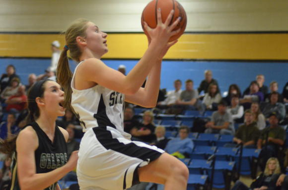 Sterling sophomore Andi Dowell goes for a layup past Central Plains freshman Taylor Rolfs on Friday. Dowell led the No. 2 Lady Black Bears with 23 points in the win.