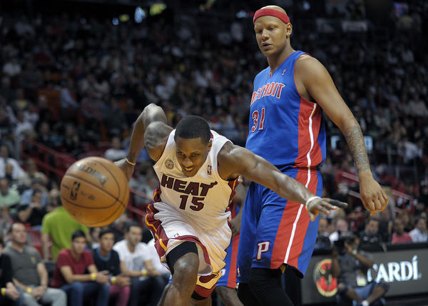Miami Heat guard Mario Chalmers tries to chase down the ball in front of Detroit Pistons forward Charlie Villanueva during the first half of their game.