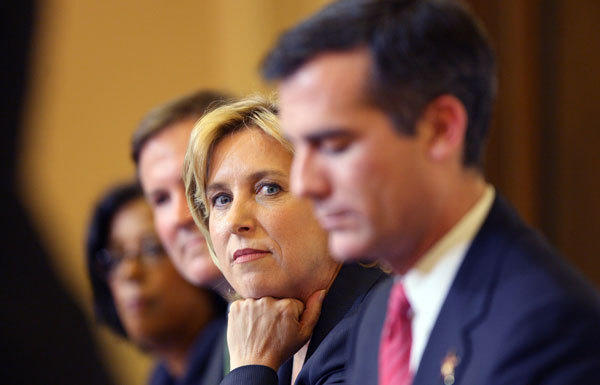 L.A. mayoral candidates Eric Garcetti, right, and Wendy Greuel -- with Kevin James and Jan Perry in the background -- at a debate in September.