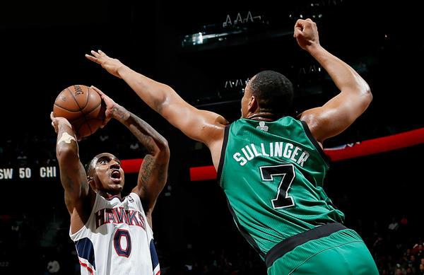 Jeff Teague #0 of the Atlanta Hawks shoots against Jared Sullinger #7 of the Boston Celtics at Philips Arena on January 25, 2013 in Atlanta, Georgia.