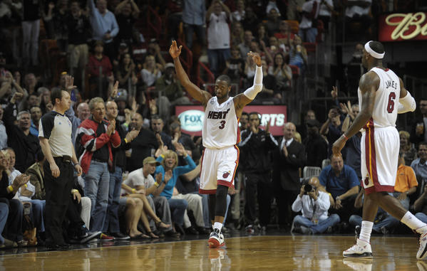 Miami Heat guard Dwyane Wade pumps up the crowd after completing a series of exciting plays against the Detroit Pistons.