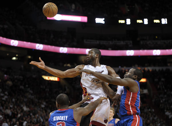 Miami Heat guard Dwyane Wade lobs the ball to LeBron James for a dunk during the first half against the Detroit Pistons.