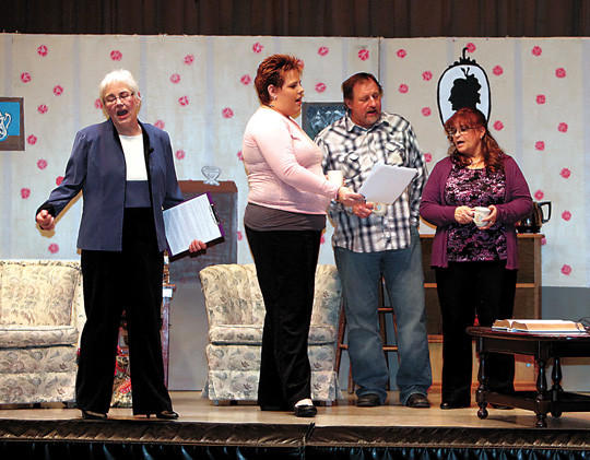 From left, Tena Gibson, Elise Schmidt, Lee Linderman and Brenda Prater sing a song as they rehearse a scene in the play One Dream, which will be performed as a fundraiser on Sunday in Ipswich.