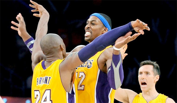 Kobe Bryant, Dwight Howard and Steve Nash celebrate during the Lakers' 102-84 victory over the Utah Jazz.