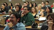 Participants react to a presentation during the Marketing Seminar.