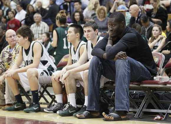 Brethren Christian's Mamadou Ndiaye, right, sits on the bench during an Academy League game against Sage Hill on Friday at Ocean View High.