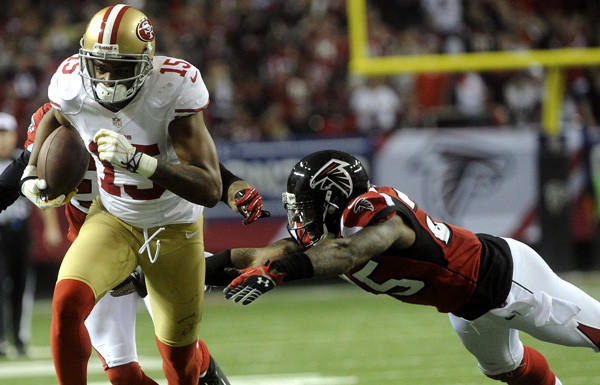 49ers receiver Michael Crabtree gains yardage after making a reception against the Atlanta Falcons in the second half of the NFC championship game on Sunday.