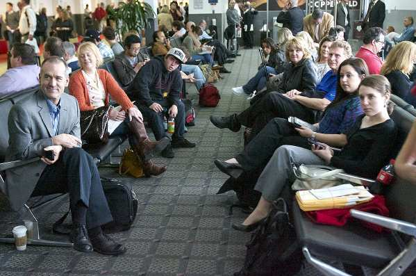 Travelers waiting for their flight turn to listen to the introduction of Kyle Bolor, 12, at the Southwest Terminal at the Bob Hope Airport in Burbank. Southwest Airlines provided complimentary travel to Sacramento to sit courtside at a Sacramento Kings basketball game where he will be the guest of honor. Kyle's father was killed in Iraq 10 years ago, and in conduction with Honoring our Fallen, the 10th anniversary of his father's death is being recognized.