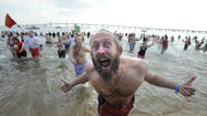 Polar Bear Plunge draws thousands to frigid bay waters
