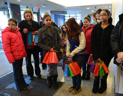 Hereford Elementary School students and families wait in the lobby before delivering handmade quilts to the NIC unit at Lehigh Valley Hospital in Salisbury Township on Saturday. The Hereford Quilters, an after school quilting club is made up of Hereford Elementary School students.