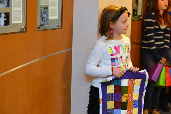 Hereford Elementary School 5th grader Kyleigh Duhaime, 10, folds her quilt before delivering handmade quilts to the NIC unit at Lehigh Valley Hospital in Salisbury Township on Saturday. The Hereford Quilters, an after school quilting club that is made up of Hereford Elementary School students.