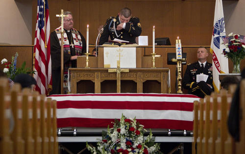 Army Staff Sgt. Nicholas Alexander Cazel tears up while speaking at the funeral of Sgt. David James Chambers at Fox Hill Central United Methodist Church in Hampton on Saturday.