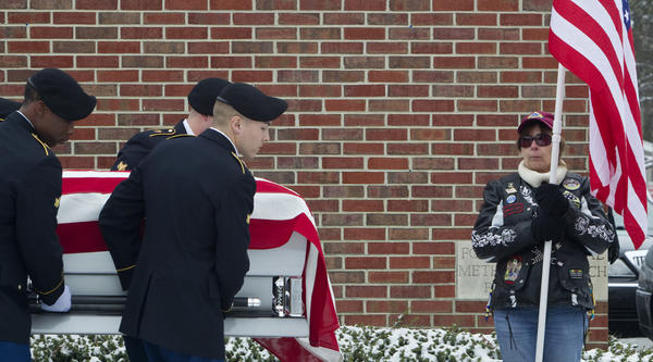 Members of a Fort Eustis Honor Guard carry the casket of Sgt. David James Chambers following a funeral service at Fox Hill United Methodist Church in Hampton on Saturday.