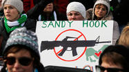 Newtown residents joined thousands of marchers who rallied in the U.S. capital in favor of gun control on Saturday, including residents of Newtown, Conn., where a mass elementary school shooting reignited the U.S. gun violence debate.