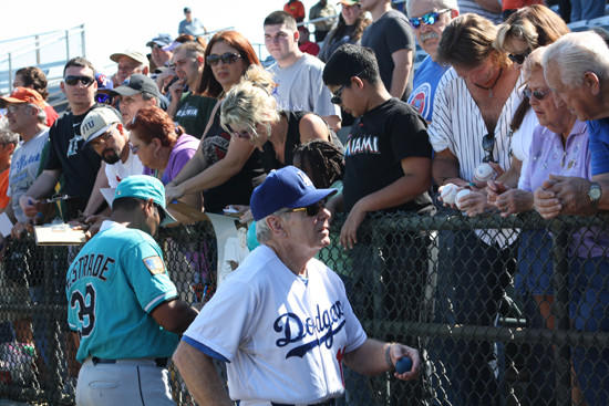 Former Marlins manager Jeff Torborg, right, talks to fans before the Joe DiMaggio Legends Game at Fort Lauderdale Stadium. Orestes Destrade is at left. (Craig Davis, Sun Sentiinel).
